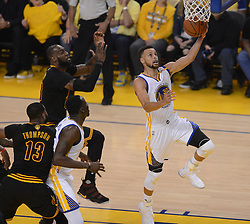 The Golden State Warriors' Stephen Curry (30) drives past the Cleveland Cavaliers' LeBron James (23) in the first quarter of Game 5 of the NBA Finals at Oracle Arena in Oakland, Calif., on Monday, June 12, 2017. (Photo by Dan Honda/Bay Area News Group/TNS) *** Please Use Credit from Credit Field ***