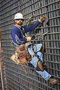 Construction Worker Hanging On Rebar
