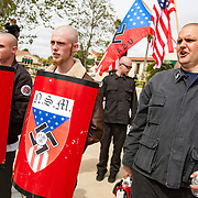 Members of the National Socialist Movement, a Neo Nazi group, rallies in Claremont, California against illegal immigration. Police ready to escort the NSM out of the demonstration zone to protect against confrontation with counter protesters. Members of the National Socialist Movement, a Neo Nazi group, rallies in Claremont, California against illegal immigration. Police ready to escort the NSM out of the demonstration zone to protect against confrontation with counter protesters.