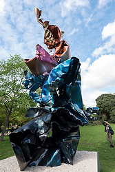 """© Licensed to London News Pictures. 07/10/2020. LONDON, UK. A woman views """"Lupine Tower"""", 2020, by Arne Quinze at Frieze Sculpture, an annual exhibition of outdoor works by international artists in Regent's Park.  The works are on display to the public until 18 October.  Photo credit: Stephen Chung/LNP"""