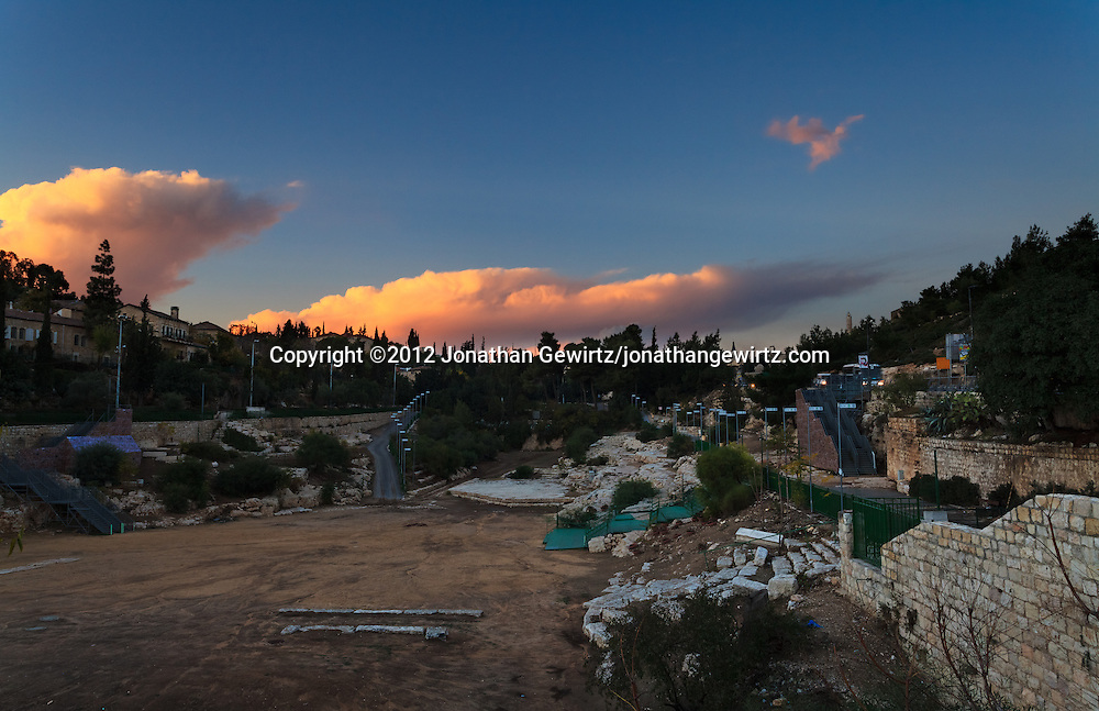 The Sultan's Pool -- the remains of an ancient water reservoir used until the late Ottoman period -- lie in the valley between Mount Zion and the walls of the Old City of Jerusalem on one side and Yemin Moshe on the other. WATERMARKS WILL NOT APPEAR ON PRINTS OR LICENSED IMAGES.