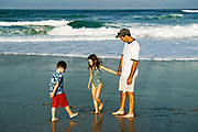 Father enjoys quality time with his kids at the beach