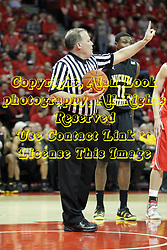 17 February 2013:  referee Gerry Pollard calls one shot during a free throw during an NCAA Missouri Valley Conference mens basketball game where the Shockers of Wichita State played the Illinois State Redbirds  in Redbird Arena, Normal IL