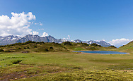 Alpine meadow and tarn at Spencer Bench in the Chugach National Forest in Southcentral Alaska. Summer. Afternoon.