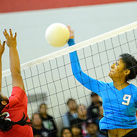102314  Adron Gardner/Independent<br /> <br /> Crown point Eagle Kitana Kenneth (26) attempts to block a spike from Navajo Prep Eagle LeShauntai Adams (9) in Crownpoint Thursday.