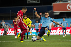 July 8, 2018 - Bronx, New York, United States - New York City defender BEN SWEAT (2) blocks a shot by New York Red Bulls defender CONNOR LADE (5) during a regular season match at Yankee Stadium in Bronx, NY.  New York City FC defeats the New York Red Bulls 1 to 0 (Credit Image: © Mark Smith via ZUMA Wire)