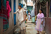 Nazma Akter (left) and Khadiza Akter out visting garment workers in Dhaka, Bangladesh. <br /> <br /> Nazma is the President of Awaj Foundation. The Foundation was founded by Zazma in 2003 to support and empower garment workers to negotiate safer and fairer working conditions.