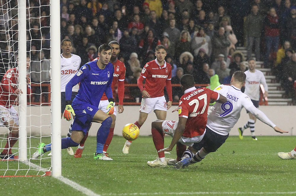 Preston North End's Louis Moult scores his sides first goal   beating Nottingham Forest's Costel Pantilimon<br /> <br /> Photographer Mick Walker/CameraSport<br /> <br /> The EFL Sky Bet Championship - Nottingham Forest v Preston North End - Saturday 8th December 2018 - The City Ground - Nottingham<br /> <br /> World Copyright © 2018 CameraSport. All rights reserved. 43 Linden Ave. Countesthorpe. Leicester. England. LE8 5PG - Tel: +44 (0) 116 277 4147 - admin@camerasport.com - www.camerasport.com