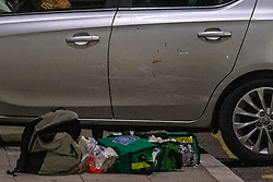 © Licensed to London News Pictures. 13/05/2020. London, UK. A car that has collided with a wall on Lombard Street sits on the pavement alongside medical packs, the car has blood on the back door. Police were called at around 1800BST on Wednesday, 13 May, to reports of a man with a knife in Lombard Road, SW11. There were also reports of a car in collision with a wall in Lombard Road. Officers attended the location and found two men injured - one had cuts to his arms and the other cuts to his legs. Officers believed the two men had been travelling in the car. Both have been taken to hospital, where their injuries are not believed to be life-threatening. Investigations at the scene led officers to Vicarage Crescent, SW11, where they found two other injured men. Both were taken to hospital with non life-threatening injuries. Photo credit: Peter Manning/LNP