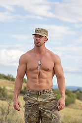 shirtless muscular solider outdoors