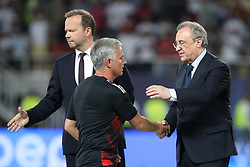 Manchester United manager Jose Mourinho shakes hands with Manchester United vice-chairman Ed Woodward and Read Madrid president Florentino Perez (right) after the UEFA Super Cup match at the Philip II Arena, Skopje, Macedonia.