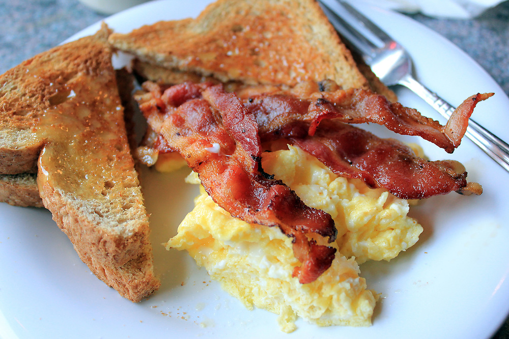 Breakfast. Bacon and eggs with toast.
