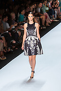 Black, gray and white print halter-top dress with black sequined top. By Monique Lhuillier at Spring 2013 Fall Fashion Week in New York.
