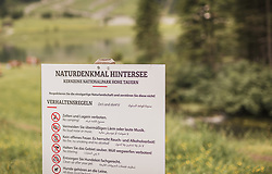 THEMENBILD - ein Schild mit Verhaltensregel am Naturdenkmal Hintersee in den Sprachen Deutsch, Englisch und Arabisch. Der Hintersee ist ein kleiner Gebirgssee in 1313 m Höhe im Talschluss des Felbertals in Mittersill. Der Bergsee ist ein Naturdenkmal und wurde unter Schutz gestellt. Der Hintersee gilt als Geheimtipp, Erholungsgebiet und ein Platz, den man gesehen haben muss, aufgenommen am 23. Juni 2019, am Hintersee in Mittersill, Österreich // a sign with a rule of conduct at the natural monument Hintersee in German, English and Arabic. Hintersee is a small mountain lake 1313 m above sea level at the end of the Felbertal valley in Mittersill. The mountain lake is a natural monument and was placed under protection. The Hintersee is an insider tip, a place you must have seen and a recreation area on 2019/06/23, Hintersee in Mittersill, Austria. EXPA Pictures © 2019, PhotoCredit: EXPA/ Stefanie Oberhauser
