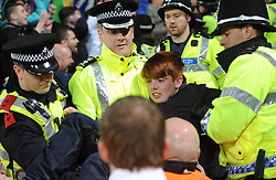 Young Swansea fan gets escorted by police over the railings.- Photo mandatory by-line: Alex James/JMP - Tel: Mobile: 07966 386802 03/11/2013 - SPORT - FOOTBALL - The Cardiff City Stadium - Cardiff - Cardiff City v Swansea City - Barclays Premier League