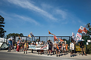 Activists from HS2 Rebellion and Extinction Rebellion UK pass a gate to a HS2 construction site as they take part in a 'Rebel Trail' hike along the route of the HS2 high-speed rail link on 26th June 2020 in Harefield, United Kingdom. The activists, who departed from Birmingham on 20th June and will arrive outside Parliament in London on 27th June, are protesting against the environmental impact of the high-speed rail link and questioning the viability of the £100bn+ project.