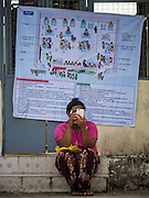 08 NOVEMBER 2015 - YANGON, MYANMAR:  A woman checks her smart phone after voting in her polling place in North Okkalapa, a township outside of Yangon center. The citizens of Myanmar went to the polls Sunday to vote in the most democratic elections since 1990. The National League for Democracy, (NLD) the party of Aung San Suu Kyi is widely expected to get the most votes in the election, but it is not certain if they will get enough votes to secure an outright victory. The polls opened at 6AM. In Yangon, some voters started lining up at 4AM and lines were reported to long in many polling stations in Myanmar's largest city.     PHOTO BY JACK KURTZ