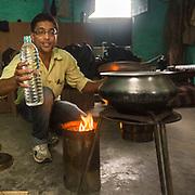 CAPTION: Demonstrating the operation of DESI Power's pioneering 'smokeless chulha' cooking stove. LOCATION: Gayari, Araria District, Bihar, India. INDIVIDUAL(S) PHOTOGRAPHED: Touqeer Zaman.