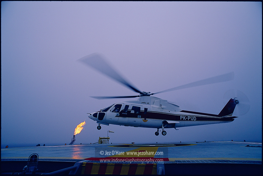 Pelita Air Service Sikorsky S76 helicopter at a gas production platform near Natuna, South China Sea, Indonesia.