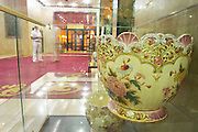 The lobby at the Hotel Crna Gora, one of several big china bowls displayed in a display case, given to the hotel as a present from the communist party. Podgorica capital. Montenegro, Balkan, Europe.