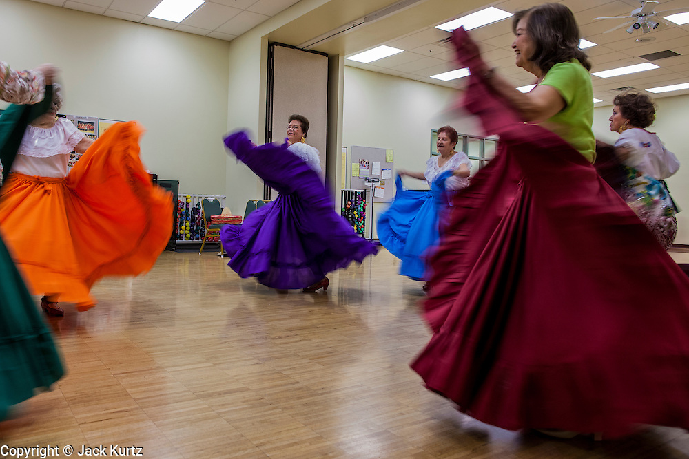27 JUNE 2012 - GLENDALE, AZ:  The Senior Fiesta Dancers rehearse at the Glendale Adult Center, in Glendale, AZ, a suburb of Phoenix. Dancing as a part of workout regimen is not unusual, but the Senior Fiesta Dancers use Mexican style folklorico dances for their workouts. The Senior Fiesta Dancers have been performing together for 15 years. They get together every week for rehearsals and perform at nursing homes and retirement centers in the Phoenix area once a month or so. Their energetic Mexican folklorico dances keep them limber and provide a cardio workout.   PHOTO BY JACK KURTZ