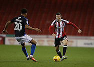 Danny Lafferty of Sheffield Utd and Darnell Furlong of Swindon Town during the English League One match at Bramall Lane Stadium, Sheffield. Picture date: December 10th, 2016. Pic Simon Bellis/Sportimage