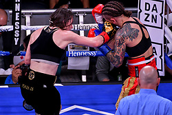 December 15, 2018 - New York, New York, USA - KATIE TAYLOR (solid black trunks with gold trim) and EVA WAHLSTROM battle in a bout for the IBF and WBA womenÃ•s lightweight titles at Madison Square Garden in New York, New York. (Credit Image: © Joel Plummer/ZUMA Wire)