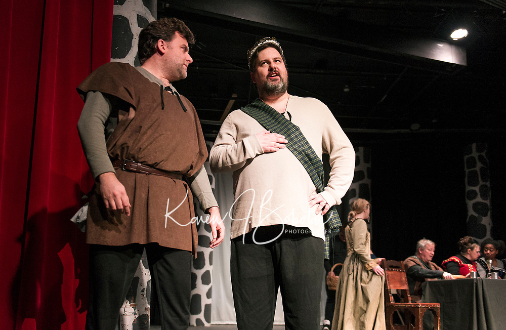 """David Nelson (porter) and Brendan Berube (Macbeth) on stage for dress rehearsal of """"Macbeth"""" with the Streetcar Company Theater at Laconia High School on Wednesday evening.  (Karen Bobotas/for the Laconia Daily Sun)"""