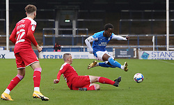 Siriki Dembele of Peterborough United skips over Paul Caddis of Swindon Town - Mandatory by-line: Joe Dent/JMP - 03/10/2020 - FOOTBALL - Weston Homes Stadium - Peterborough, England - Peterborough United v Swindon Town - Sky Bet League One