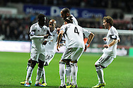 Swansea city's Nathan Dyer (l) celebrates with a dance with his teammates after he scores the 1st goal. Barclays Premier League match, Swansea city v Newcastle Utd at the Liberty stadium in Swansea, South Wales on Wednesday 4th Dec 2013. pic by Andrew Orchard, Andrew Orchard sports photography,
