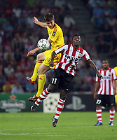Photo: Chris Ratcliffe.<br /> PSV Eindhoven v Liverpool. UEFA Champions League, Group C. 12/09/2006.<br /> Xabi Alonso of Liverpool clashes with Edison Mendez of PSV Eindhoven.