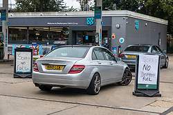 Licensed to London News Pictures. 25/09/2021. London, UK. Large signs of 'no fuel' at a Co-op petrol station on the A3 in Roehampton, south-west London this morning as desperate motorists stop to fill up, only to discover the garage has run out of fuel. Yesterday, Large queues formed at petrol stations across London with many running out of fuel as oil giants struggle to maintain deliveries due to the lack of HGV drivers. Photo credit: Alex Lentati/LNP