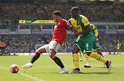 Memphis Depay of Manchester United (L) and Sebastien Bassong of Norwich City in action - Mandatory by-line: Jack Phillips/JMP - 07/05/2016 - FOOTBALL - Carrow Road - Norwich, England - Norwich City v Manchester United - Barclays Premier League