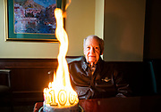"""WWII veteran Bob Masonheimer smiles next to his flaming birthday cake at Liberty Heights Retirement Community in celebration of his 100th birthday in Colorado Springs, Colorado. Masonheimer was a WWII bomber pilot stationed in Japan and had a marriage with his life's love, Maxine, for 73 years. His personal belief was to keep his emotions under control, even in the most perilous situations. His friends, like fellow veteran Ernie Gudridge, marveled at his fearlessness. """"Such control,"""" Gudridge, 97, said. """"Such courage. He used his talents to the utmost, and I swear he would get everybody on that crew to be better than they thought they could be."""""""
