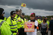 Anti-fracking  activists and protesters outside the gates of Quadrillas fracking site June 31st, New Preston Road, Lancashire, United Kingdom. The struggle against fracking in Lancashire has been going on for years. The fracking company Quadrilla is finally ready to bring in a drill tower to start drilling and anti-frackinhg activists are waiting in front of the gates to block the equipment getting in. Fracking is a destructive and potential dangerous and highly contentious method of extracting gas and this site will be the first of many in the United Kingdom reaching miles out under ground.