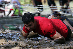 "©Licensed to London News Pictures. 13/05/2012.Boughton House, Northants. Tough Mudders tackle the barbe wire ""Kiss of Mudd"" during 12 mile endurance challenge..Photo credit: Steven Prouse/ LNP"