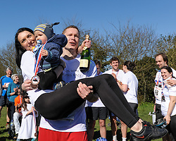 © Licensed to London News Pictures. 16/03/2014. Dorking, UK. The 7th UK Wife Carrying Race. second place Vytautas Kirkliauskas and wife Neringa who travelled from Lithuania. Photo credit : Julie Edwards/LNP