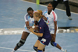 Signate Mariama of France and Hrnjic Manuela of Slovenia during handball match between National teams of Slovenia and France of 2011 Women's World Championship Play-off, on June 12, 2011 in Arena Stozice, Ljubljana, Slovenia. (Photo By Urban Urbanc / Sportida.com)