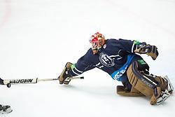 Jan Mursak (Amur Khabarovsk, #13) vs Barry Brust (KHL Medvescak Zagreb, #33) on a breakaway during KHL League ice hockey match between KHL Medvescak Zagreb and Amur Kharabovsk, on October 28, 2013 in Dvorana Sportova, Zagreb, Croatia. (Photo By Matic Klansek Velej / Sportida)