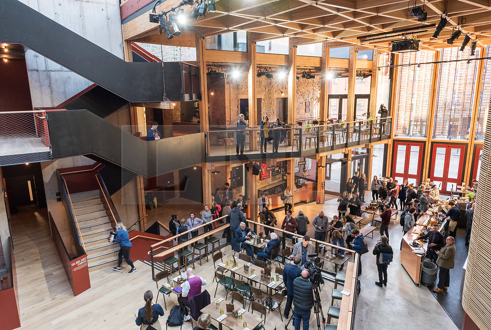 © Licensed to London News Pictures. 24/09/2018. Bristol, UK. The Bristol Old Vic Theatre in King Street reopens on Monday 24th September following a multi-million-pound transformation. Picture shows the foyer. The dramatic redevelopment, by leading theatre and Stirling prize-winning architects Haworth Tompkins, is designed to create a warm and welcoming venue to attract wider, more diverse audiences, and to place the theatre at the heart of the city's public and cultural life. A full-height timber and glass-fronted foyer, revealing the original auditorium façade to the street for the first time, acts like a covered public square. Huge sun-shading shutters, incorporating the text of Garrick's inaugural 1766 address and a poem by former Bristol city poet Miles Chamber, highlight the theatre's long history and look forward to its future role in the whole community. The internal layout of the theatre has also been completely transformed, with the restoration of the Georgian Coopers' Hall as a public assembly room for Bristol, a new studio theatre created in the old barrel vaults, mezzanine galleries, winding staircases and viewing platforms. Together, they provide new flexible spaces for productions, events, experimental theatre and city-wide participation. The Bristol Old Vic is the oldest continuously working theatre in the English speaking world. Photo credit: Simon Chapman/LNP