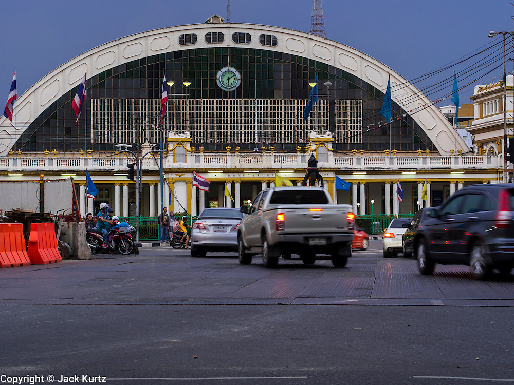 10 SEPTEMBER 2013 - BANGKOK, THAILAND:  Hua Lamphong Grand Central Railway Station, officially known as the Bangkok Grand Central Terminal Railway Station, is the main railway station in Bangkok, Thailand. It is located in the center of the city in Pathum Wan District, and is operated by the State Railway of Thailand. The station was opened on 25 June 1916, after six years' construction. The station was built in an Italian Neo-Renaissance style, with decorated wooden roofs and stained glass windows. The architecture is attributed to Turin-born Mario Tamagno, who, with countryman Annibale Rigotti made a mark on early 20th century public building in Bangkok. The pair also designed Bang Khun Prom Palace (1906), Ananda Samakhom Throne Hall in The Royal Plaza (1907-15) and Suan Kularb Residential Hall and Throne Hall in Dusit Garden, among other buildings. There are 14 platforms and 26 ticket booths. Hua Lamphong serves over 130 trains and approximately 60,000 passengers each day. Thailand has the most advanced rail system in Southeast Asia and trains from Hua Lamphong serve all corners of the Kingdom.      PHOTO BY JACK KURTZ
