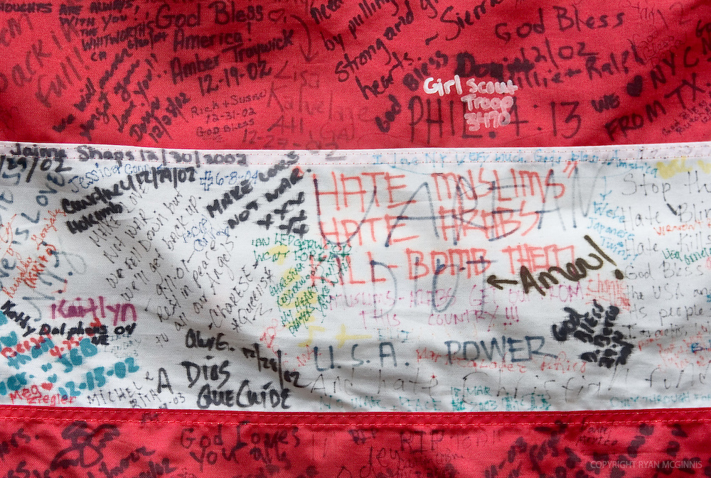 Inscriptions on an American flag at ground zero of the World Trade Center terrorist attacks, August 15, 2006.