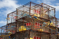 """Stack of King crab pots rigged with orange """"triggers"""" for Pacific cod fishery, in Kodiak, Alaska."""