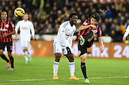 QPR's Yun Suk-Young clears from Swansea's Wilfried Bony. Barclays Premier league match, Swansea city v Queens Park Rangers at the Liberty stadium in Swansea, South Wales on Tuesday 2nd December 2014<br /> pic by Andrew Orchard, Andrew Orchard sports photography.