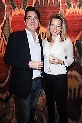 CHARLIE & LAURA ROBERTSON at the opening of Luke Irwin's showroom at 22 Pimlico Road, London SW1 on 24th November 2010.