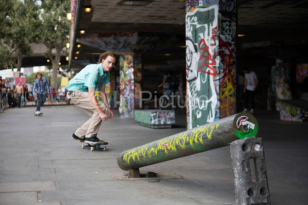 Young men practise their skateboarding tricks at the Undercroft on the Southbank, London, United Kingdom. The undercroft of the foyer building of the Queen Elizabeth Hall on the South Bank has been popular with skateboarders since the early 70's and it is widely acknowledged to be London's most distinctive and popular skateboarding area. The area is used by skateboarders, BMXers, graffiti artists, taggers, photographers, buskers, and performance artists, among others. The South Bank is a significant arts and entertainment district, and home to an endless list of activities for Londoners, visitors and tourists alike. (photo by Mike Kemp/In Pictures via Getty Images)