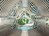 Aerial view of park in the heart of a modern, curved and  futurist office building in Singapore.
