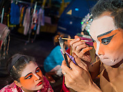 16 JANUARY 2015 - BANGKOK, THAILAND: A performer with the Sai Yong Hong Opera Troupe puts on his make up before performing at the Chaomae Thapthim Shrine, a Chinese shrine in a working class neighborhood of Bangkok near the Chulalongkorn University campus. The troupe's nine night performance at the shrine is an annual tradition and is the start of the Lunar New Year celebrations in the neighborhood. Lunar New Year, also called Chinese New Year, is officially February 19 this year. Teochew opera is a form of Chinese opera that is popular in Thailand and Malaysia.    PHOTO BY JACK KURTZ