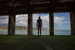 """@Licensed to London News Pictures 31/08/2017 Folkestone, Kent. 'Another Time XVIII 2013"""" sculpture is situated at the Loading Bay on the Harbour Arm during Folkestone Triennial 2017. The sculptor Antony Gormley has erected two more statues one in Margate and the other in Folkestone Harbour Arm. Folkestone Triennial is the flagship project of the Creative Foundation, an independant arts charity enabling the regeneration of the seaside town of Folkestone in Kent through creative activity. Photo credit: Manu Palomeque/LNP"""