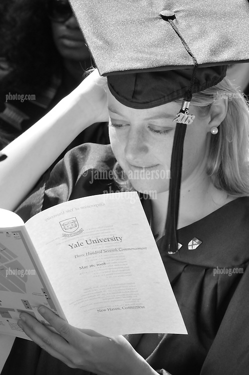 A 'soon to be' Yale Graduate taking a moment to read the Program at the 2008 Yale Commencement. Ceremonies on Old Campus, Yale University, New Haven, CT